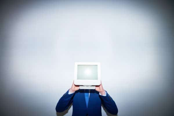 Man with computer monitor instead of head