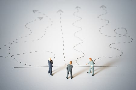 Business decision concept. Businessmen standing and giving advice with arrow pathway choice.